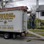 The Rhode Island Slate Roofing Truck in front of a Job in Providence Rhode Island