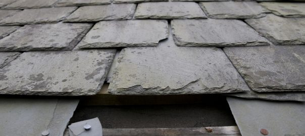 Damaged Slate Roof with missing shingles